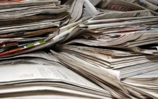 Photo of a stack of newspapers.