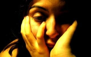 Photo of depressed woman.