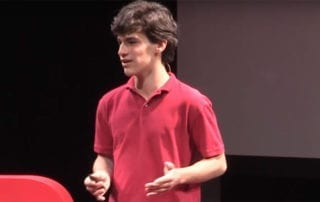 Photo of Jonas Kolker speaking at a TED symposium.