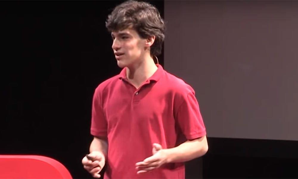 Photo of Jonas Kolker speaking at a TED symposium.