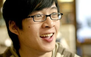 Photo of smiling teen.