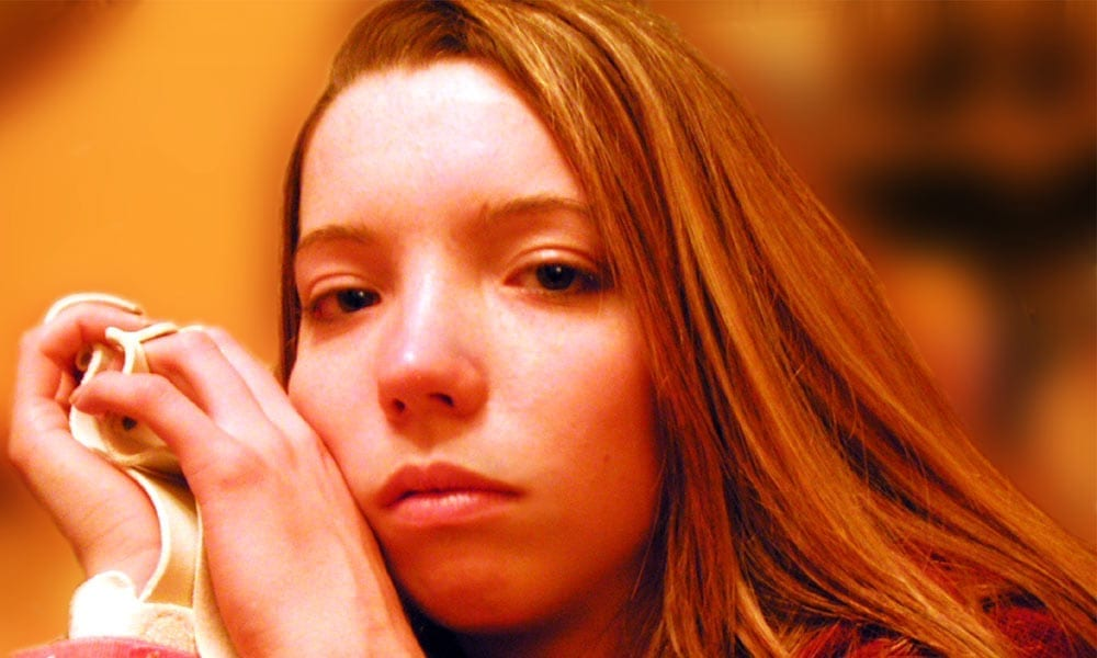 Photo of sad female teen.